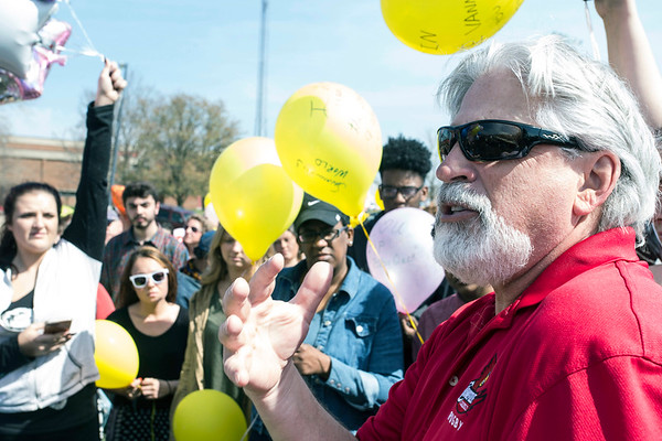 Dean Walker addresses a crowd gathered for a balloon release to honor his daughter Savannah at Ballard High on Saturday afternoon. 3/25/17