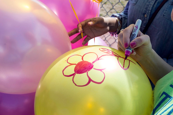 Friends and former classmates of Savannah Walker decorated balloons for a release honoring Savannah Walker at Ballard High on Saturday. 3/25/17