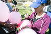 Desiree Strasser writes on a balloon to be released during a memorial for Savannah Walker at Ballard High on Saturday. 3/25/17
