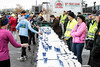 Tables of water await finishers of the Papa John's 10-Miler. 4/1/17