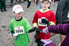 Nolan and Garrett McGovern receive their participation medals upon the completion of the Papa John's 10-Miler on Saturday. 4/1/17