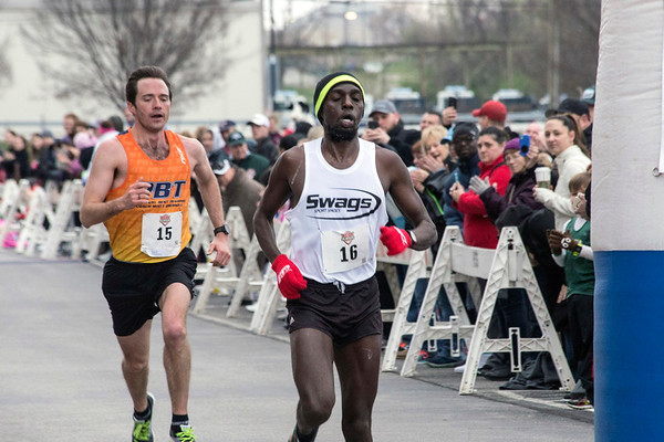 Japhet Kipkoech of Louisville nudged out Jordan Kyle of Indianapolis at the finish line for 2nd place during the Papa John's 10-Miler on Saturday morning. 4/1/17
