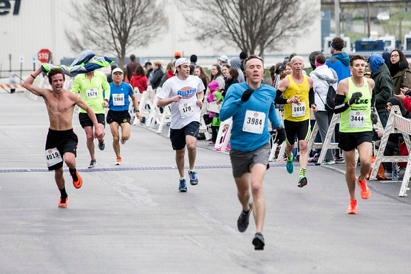 The first group of runners (after the winners) near the finish line of the Papa John's 10-Miler on Saturday. 4/1/17