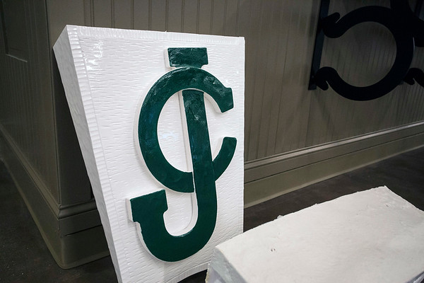 A classic Jockey Club symbol on white brick waits to be placed above a door frame as a nod to the origins of Churchill Downs. 4/4/17