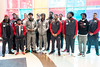 Members of the UofL football team gather in the lobby of Norton Children's Hospital on Chestnut Street before meeting with patients as part of their community service week. 4/6/17
