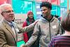 Norton staffer Thomas Kmetz greets UofL quarterback Lamar Jackson on Thursday during a football team community service tour. 4/6/17