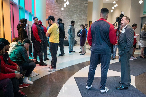 UofL football players gather in the lobby of Norton Children's Hospital before taking a tour of the facility as part of a day of community service by the team. 4/6/17