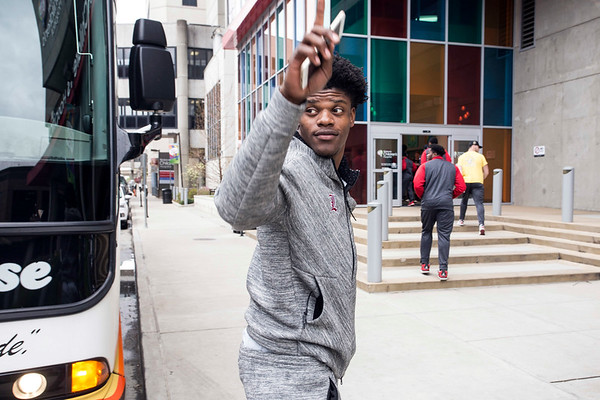 Heisman winning quarterback Lamar Jackson acknowledges a honking car on Chestnut Street before entering Norton Children's Hospital for a day of community service by the UofL football team. 4/6/17