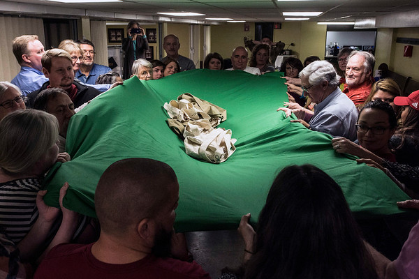 A weighted blanket collectively supported by the particpants in a Warrior's Heart  session shows the strength of acting as a community. 3/9/17
