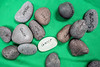 Rocks inscribed with the typical things that can complicate a happy life are placed on a blanket during a Warrior's Heart meeting. Participants collectively hoist the weighted blanket to demonstrate the power of community healing. 3/9/17