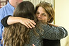 Stephanie Barnett embraces Kristen Hughes at the start of a Warrior's Heart meeting in March. 3/9/17