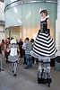 Cirque Louis stilt walker Elka Miller towers over the scene at the African American Heritage Center on Monday during the Imagine Greater Louisville 2020 event. 4/10/17