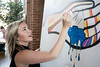 Local artist Mo McKnight Howe works on one of the several panel pieces on display promoting a new arts initiative called Imagine Greater Louisville 2020. 4/10/17