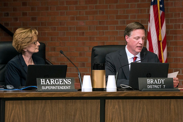 """JCPS Superintendent Donna Hargens listens as Board of Education member Chris Brady reads the announcement that Hargens will """"step down"""" from her post effective July 1, 2017. 4/13/17"""
