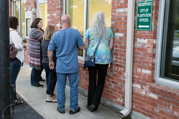 Residents of Rolling Hills watch from outside as the city's board considers terminating the contract of Kenny Betts on Tuesday night. 4/18/17