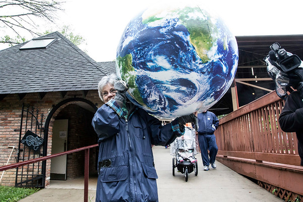 Virginia Bush carried an inflatable Earth during the 5k Louisville Earth Walk on Saturday in Iroquois Park. 4/22/17