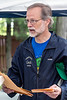 Eco-warrior Tim Darst collects registration forms during the first ever Louisville Earth Walk through Iroquois Park on Saturday. 4/22/17