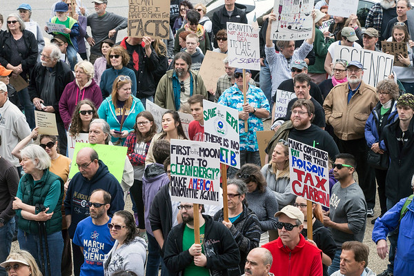 Picket signs denouncing changes to environmental policy in DC peppered a crowd in attendance for the Louisville March for Science on Sunday. 4/23/17