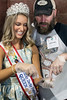 Kentucky Derby Festival Queen Natalie Brown receives a lesson on oyster shucking from Whole Foods employee Garrett Petters during the KDF Taste of Derby Festival. 4/25/17