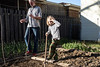 Jackie Green and Kiernan Mudd Funk work in a small garden in the Deer Park Neighborhood as part of a collecive of growers on the block. 4/7/17