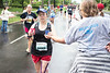A water station near the UofL campus handled the first influx of miniMarathon participants on Saturday morning. 4/29/17