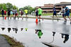 Pools of standing water from the overnight storms made for a wet course during the KDF marathons on Saturday. 4/29/17