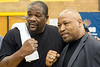 Boxing legends Riddick Bowe and Ray Mercer pose for photos while on a visit to Central High School on Wednesday morning. 5/3/17