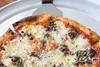 The Salsiccia pizza on the menu at Mercato Italiano in Norton Commons boasts a flavorful mix of house-made sausage, basil pesto, mozzarella, parmigiano and pomodoro. 5/23/17