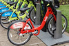 A rare number of red bikes are part of the 300 used in the LouVelo Bikeshare program as a nod to one owned by Muhammad Ali while growing up in Louisville. 5/24/17