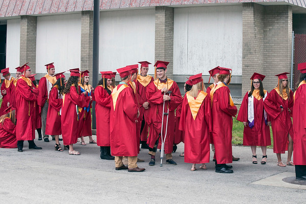 The 2017 Bullitt East High School graduating class lines up outside of Broadbent Arena on Saturday morning before their commencement ceremony. 5/27/17