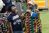 DJ Kadhabi of Detroit helps Warren Sisney find just the right hat during the Kentucky Reggae Fest on Sunday. 5/28/17