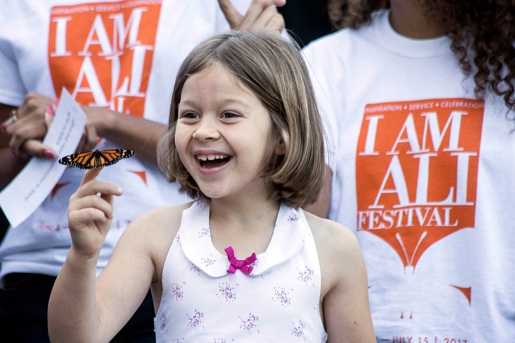 Violet Dailinger was delighted by one of the butterflies released during opening ceremonies at the I Am Ali Festival held at the Muhammad Ali Center on Saturday morning. 6/3/17
