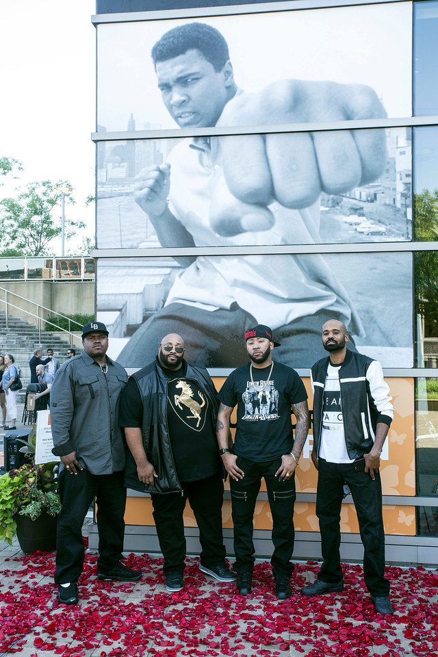 The band Linkin' Bridge took advantage of a photo opp area at the Ali Center during the start of the I Am Ali Festival on Saturday. 6/3/17