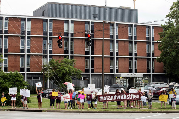 Protesters lined the sidewalk in front of the Van Hoose Education Center on Tuesday to voice concern and anger about the recent firing of Norton Elementary principal Ken Stites. 6/13/17