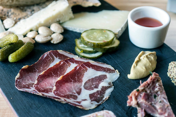 The charcuterie board at Red Hog offers a mix of cheeses and meats. 6/21/17