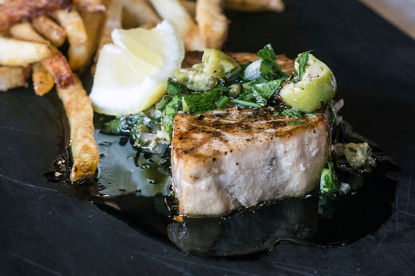 The swordfish at Red Hog is served with Castelvetrano olives and herb salsa. 6/20/17