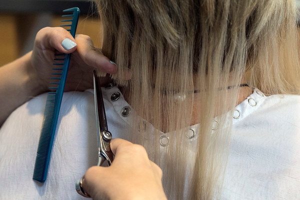 Once the hair extensions are complete, scissors are used to trim, style and match the existing hair. 7/3/17