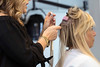 Stylist Kelly Kraemer attaches hair extensions to client Paige Burkley at Nova Salon. 7/3/17