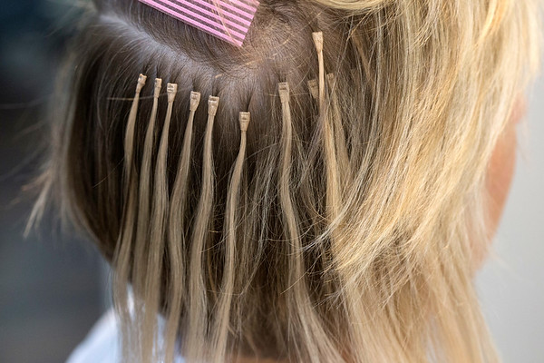 Hair extensions covering the back and side of the head will be hidden by existing hair. 7/3/17