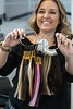 Kelly Kraemer shows off the collection of various hair extensions offered at Nova Salon. 7/3/17