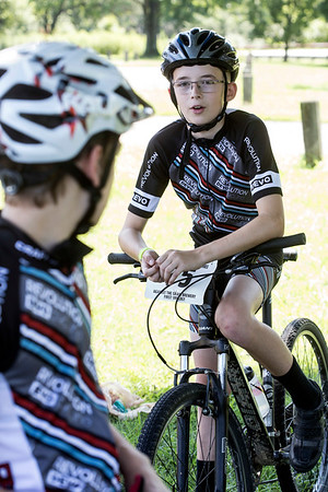 Aaron Napier talks shop with one of his Revolution Devo Cycling teammates before a ride through Seneca Park. 7/9/17