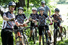 Revolution Devo Cycling coach Brian Segal provides instruction to his junior development cycle team before beginning a hill climbing exercise in Seneca Park on Sunday. 7/9/17
