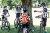 Members of the Revolution Devo Cycling team listen to coach Brian Segal during a pre-ride meeting in Seneca Park. 7/9/17