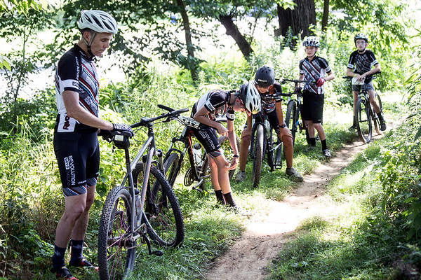 The Revolution Devo Cycling team takes a breather after rigorous training along the wooded and hilly paths of Seneca Park. 7/9/17