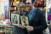 Magicians Mac King and Lance Burton hold up old promo shots that are kept behind the magic counter at Caufield's Novelty on Main Street. 7/12/17