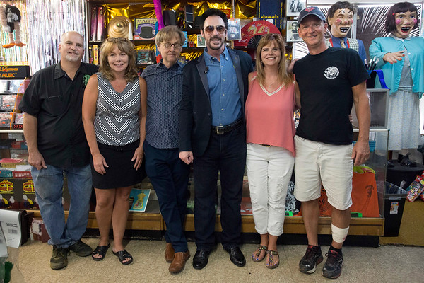 Members of the Caufield family pose with magicians Lance Burton and Mac King during a stop the two entertainers made to the Louisville landmark on Wednesday. 7/12/17