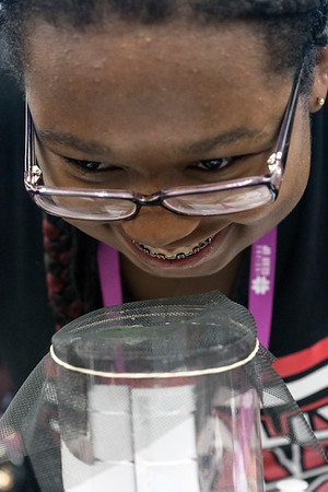 Brian White smells a polluted water sample to check her progress in a filtration system lesson at the Gear Up STEM Enrichment Camp. 7/12/17