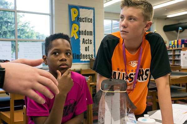 Jaden Hart and Caiden White listen during an abiotoc lesson at the Gear Up STEM Enrichment Camp. 7/12/17
