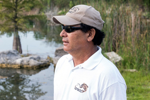 Kaoru O'Bryan watches as boats are launched into Mystery Lake for another Kentucky Pro Bass Warriors event that paired UofL football players with military veterans. 7/22/17