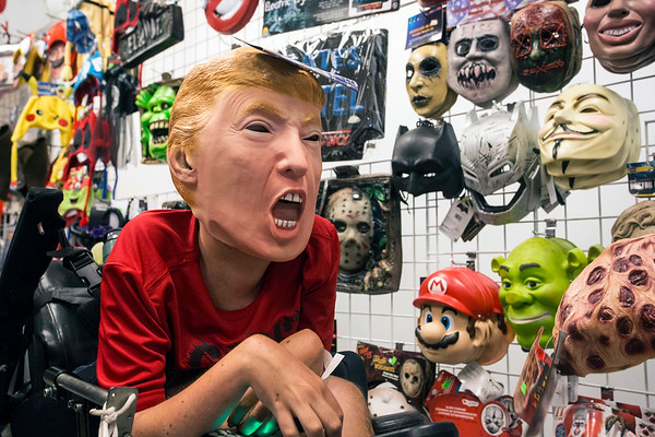 Marcus Cooley of San Francisco, CA tried on a Trump mask in the Caufield's Novelty booth at FandomFest on Saturday. 7/29/17